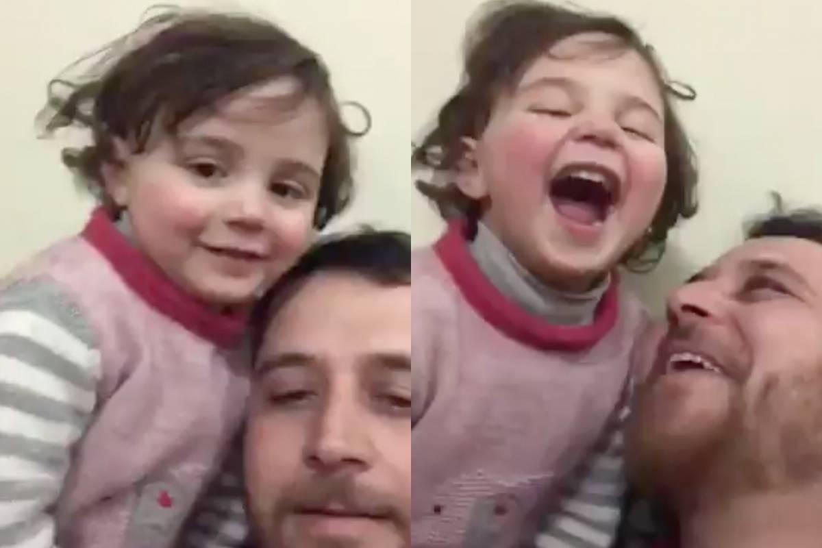 Padre le enseña a reir a su hija durante bombardeo
