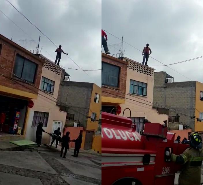 Hombre intenta lanzarse de su azotea en Toluca y policía lo detiene
