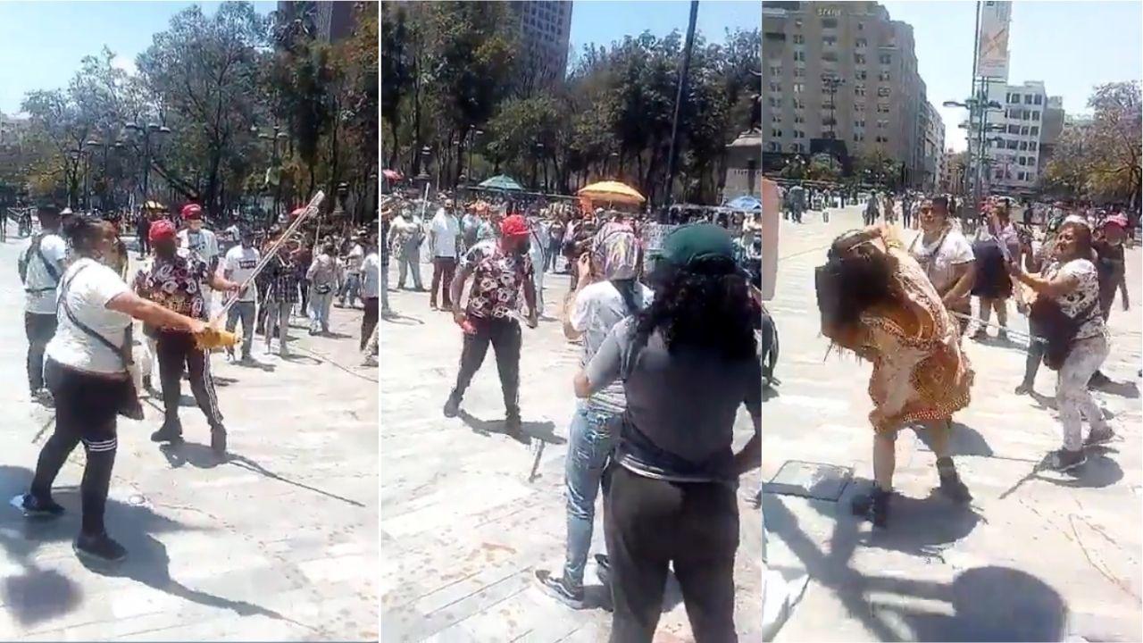 Comerciantes agreden con palos a feministas en las inmediaciones de Bellas Artes en la CDMX