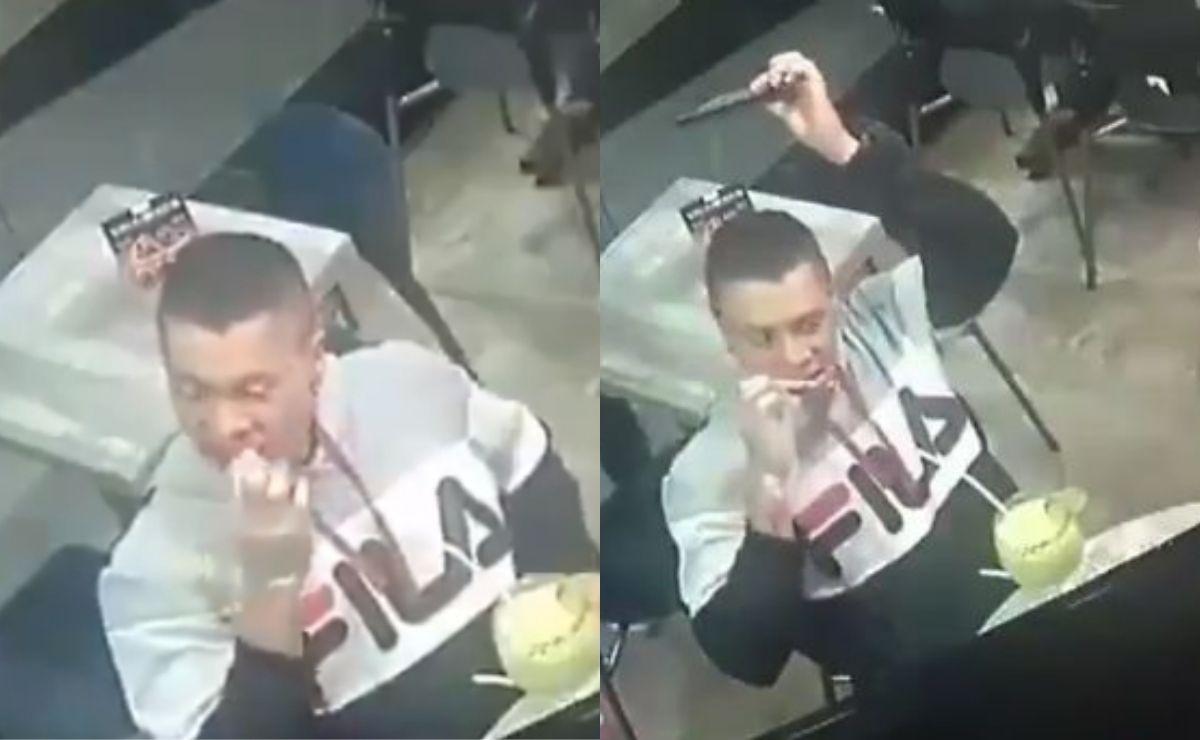 Joven no deja de comer sus alitas a pesar de estar siendo asaltado