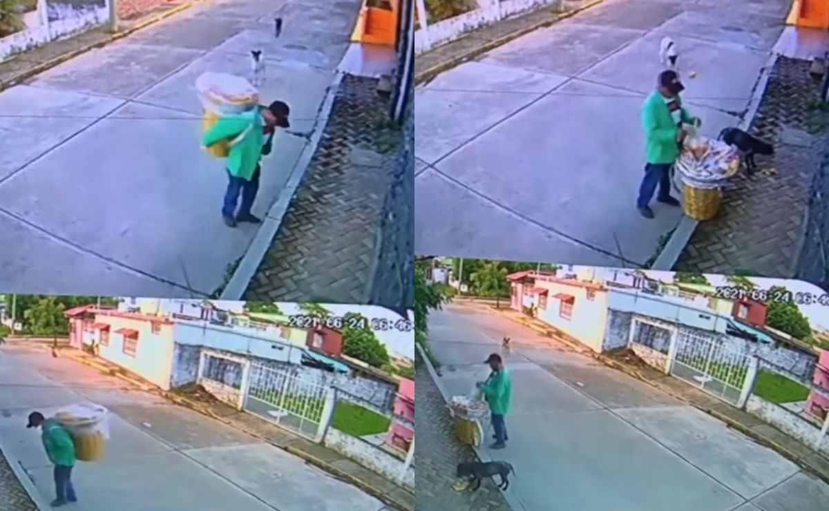 El hombre se encuentra caminando por la calle con un tambo de comida cuando unos perros llegan a pedirle comida